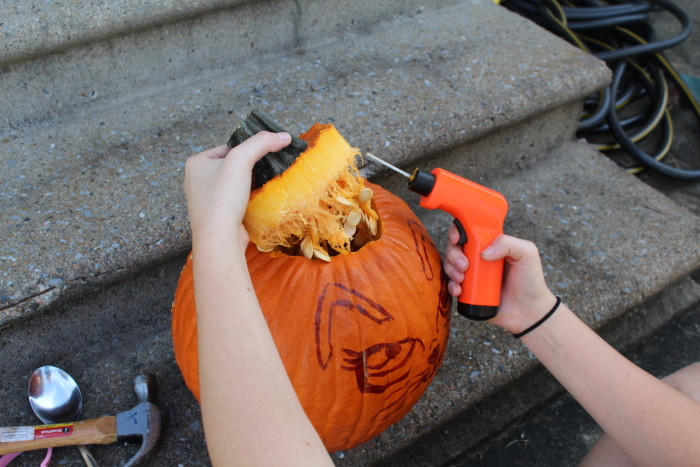 cleaning out the pumpkin