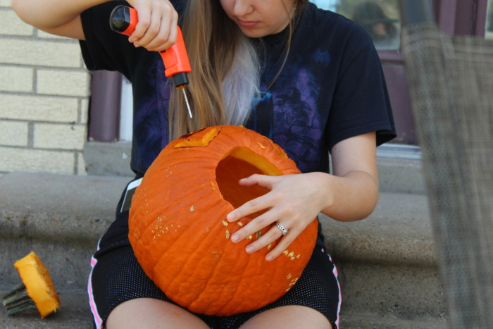 cutting her pumpkin