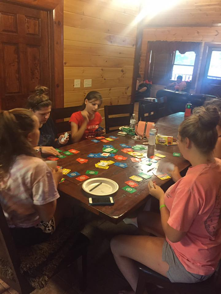 playing games on the dinner table new beginning cabin maranatha resort smoky mountain